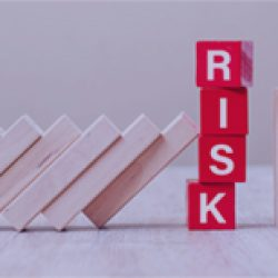 Red RISK cube blocks stop falling blocks on table. fall Business
